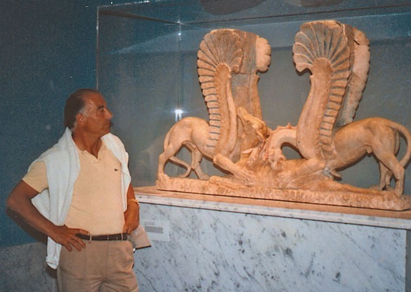 Medici standing in front of the same scupture, now restored, sold and on display in a museum